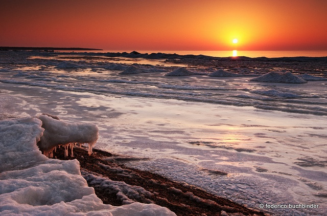 Icy Sunset by / shadows and light, via Flickr. A frosty view of Lake Winnipeg from Victoria Beach, Manitoba.