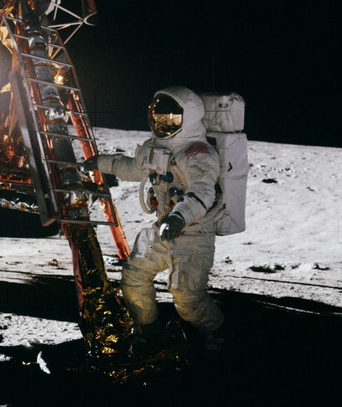 On November 19, 1969, Apollo 12 astronaut Alan Bean takes a few steps for a man to become the fourth person to walk on the Moon. If you look closely, you can see Pete Conrad reflected in Bean's visor.(NASA)