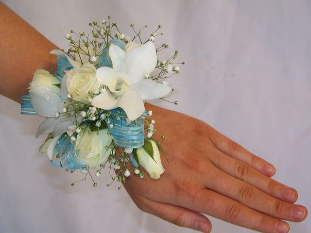white orchid and spray rose, blue ribbon  Flowers of Charlotte loves this!  Visit us at flowersofcharlotte.