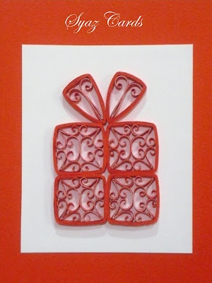 Swirled quilling for a pretty gift box design on a greeting card - by: Syaz Cards.