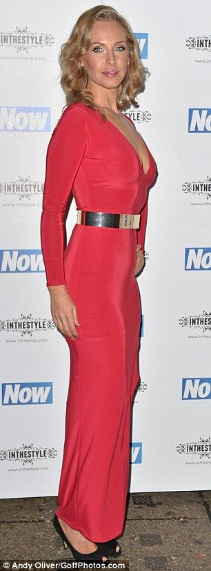 Flashing the flesh: The long red dress featured a slit on one side to show off Josie's sli...