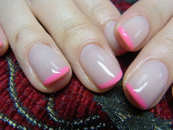 french manicure: neutral base with neon pink tips
