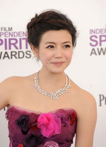 Michelle Chen Braided Updo  Michelle Chen attended the 2012 Independent Spirit Awards wearing her hair in an updo featuring a reverse French braid.