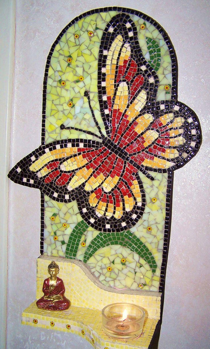 vlinder met boeddha en theelichtje