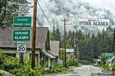"Photograph courtesy of Tom Pauser. So did you know that we have a ghost town here in Alaska? Hyder, Alaska is labeled as the ""Friendliest Ghost Town in Alaska"". With a population of only 87 and situated just across the border from Stewart, British Columbia in far southern SE Alaska, it's one of only 3 towns in the panhandle that you can drive into from the rest of the world. It also does not use the 907 area code that the rest of Alaska uses, but the Canadian area code of 250."