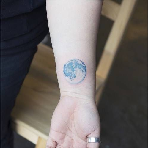 Realistic style blue moon on the wrist. Tattoo artist: Sol...