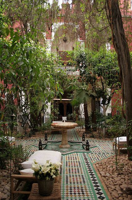 Riad Kaiss Courtyard by AnotherOz, via Flickr.  Use of river stones with outdoor tile.