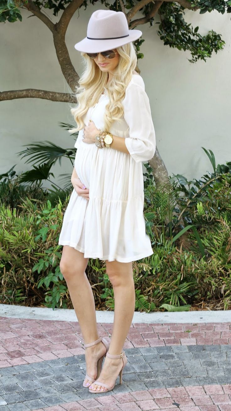 Soft flowy cream dress with gold accessories-maternity chic