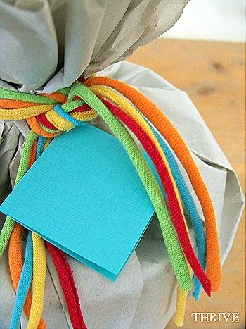 """Old t-shirts turned into package """"ribbons""""."""