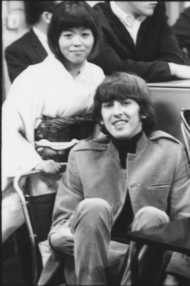 George Harrison of The Beatles with Japanese music journalist Rumiko Hoshika at EMI Studios, Abbey Road, London during the recording session for 'It's Only Love', June 15, 1965.