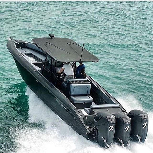 Midnight Express 39 and triple Seven Marine all black