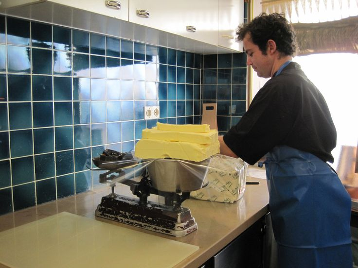 L'Or des Près butter weighed out in an old fashioined scale at Michel Chaudun's. Only the best butter goes in his chocolate.