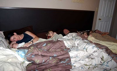 Entergently: Our family bed . . . how we make it work. Looks like they painted on a faux headboard.