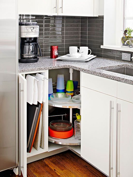 40+ Organization and Storage Hacks for Small Kitchens --> Lazy Susan corner storage to take advantage of the hard-to-reach space in the corner of a cabinet