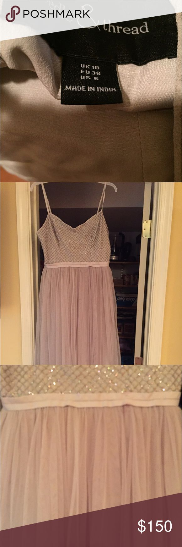 Beautiful grey dress size 6 Needle and Thread brand. Only worn once to a wedding in May. Beautiful detail. Sparkly and famine. Size 6. Bought for $260. Asking $150. Needle & Thread Dresses Midi