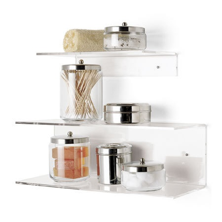 Interesting objects in clear jars for bathroom shelves