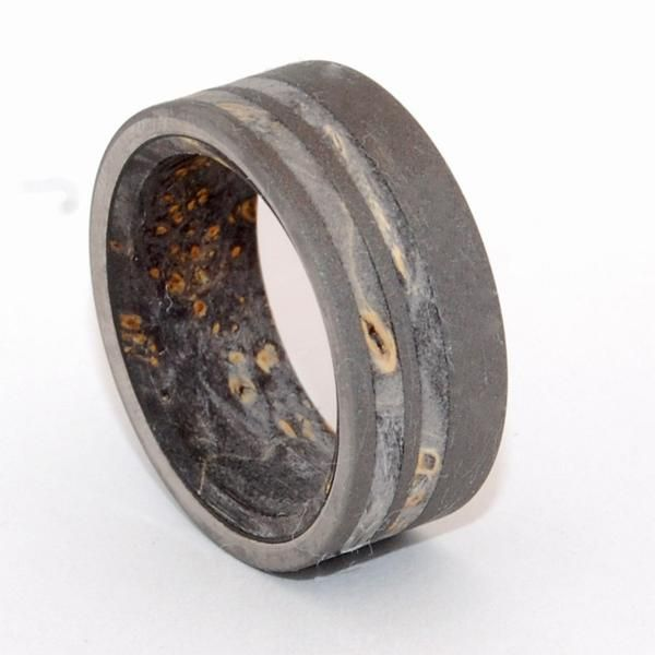 Titanium Rings - Unique Wedding Rings. Onyx. This beautifully crafted, titanium wedding band has an offset double inlay of Black Box Elder wood, and with an interior overlay of Black Box Elder. Sandblasted finish. Pictured at 9.5mm.