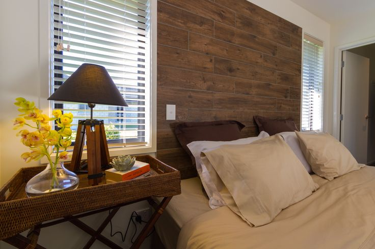 Check out the wooden feature head board in this master suite!