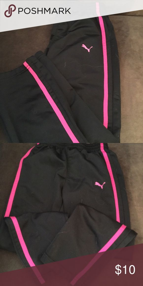 Girls black Puma track pants Black Puma track pants with pink stripe and pink Puma logo. Straight leg pants, no pockets. Pants are in great shape, lots of wear left in them Puma Bottoms Sweatpants & Joggers