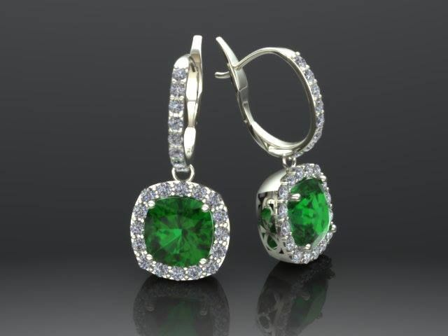White gold earrings set with diamonds and Chatham emeralds.  Created by Richard Aubin at Trek Jewellers