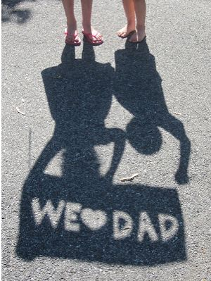 Creative kid portrait ideas: How to make a we love dad silhouette photo via crafty gator | father's day gift ideas