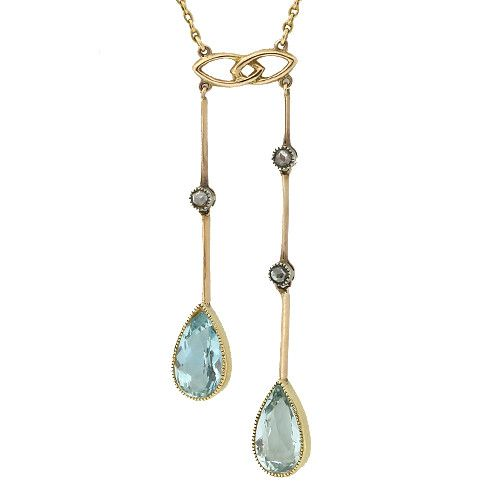 Antique negligee pendant with pear shape aquamarines and rose cut diamonds. Circa 1900. Chain length 42cm. Pendant length 4cm.