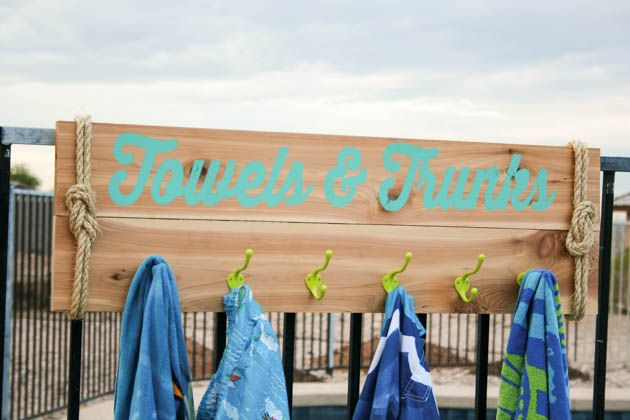 Build your own towel rack for pool or beach towels with this easy tutorial. Put a nautical twist on it with sisal rope and bright colors.