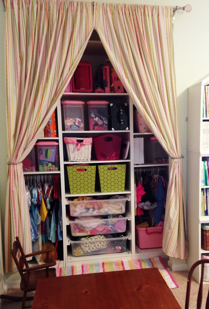 Affordable Playroom Closet:  Ikea Closet System + Target Storage bins. Curtains are sheets cut at the seam!