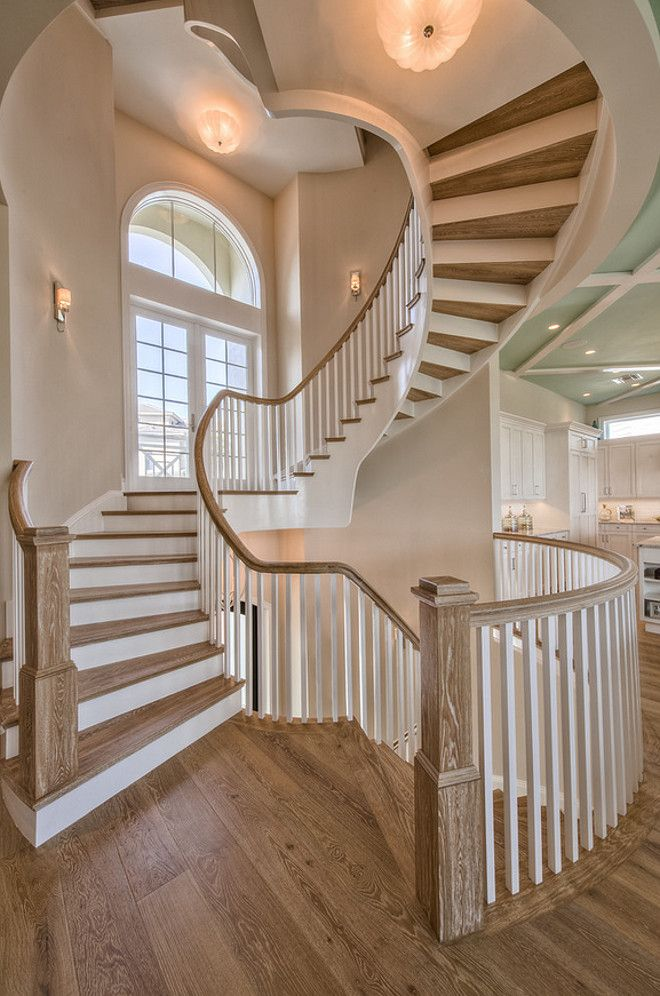 Staircase. Staircase flooring is wire brushed white oak. The designer added wood on both sides of the staircase (floor and ceiling) to add interest to the staircase.