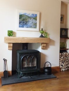 We have an electric wood burner stove - like the idea of having a rustic beam above to use as a shelf with a mirror over that.