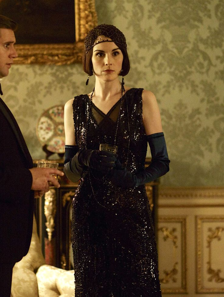 Lady Mary Crawley - Dressed in elegant black jeweled evening gown embellished with jet black jeweled head band, jet black crystal drop earrings and long necklaces.
