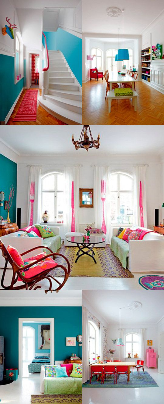 I wouldn't do it in my house, and the giant face over the bed would kind of creep me out at night....but look at all that lovely, bright colour! And the living room curtains are cool.