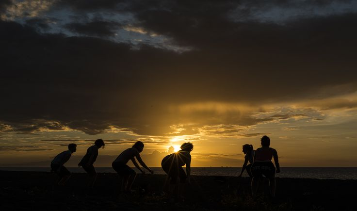 Sunset yoga on our beach, Camiguin island, Philippines