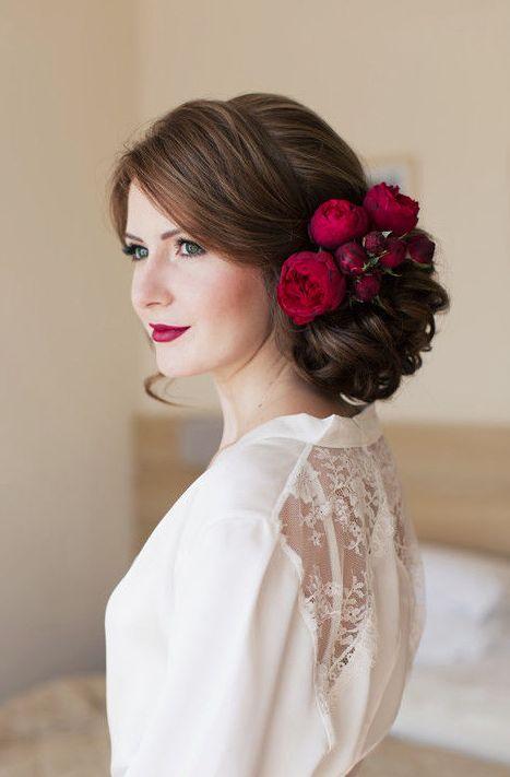 red flower hairpiece updo wedding