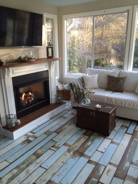 Great Sunroom ! Reclaim wood from my farm used on fireplace ! Beach house laminate flooring .