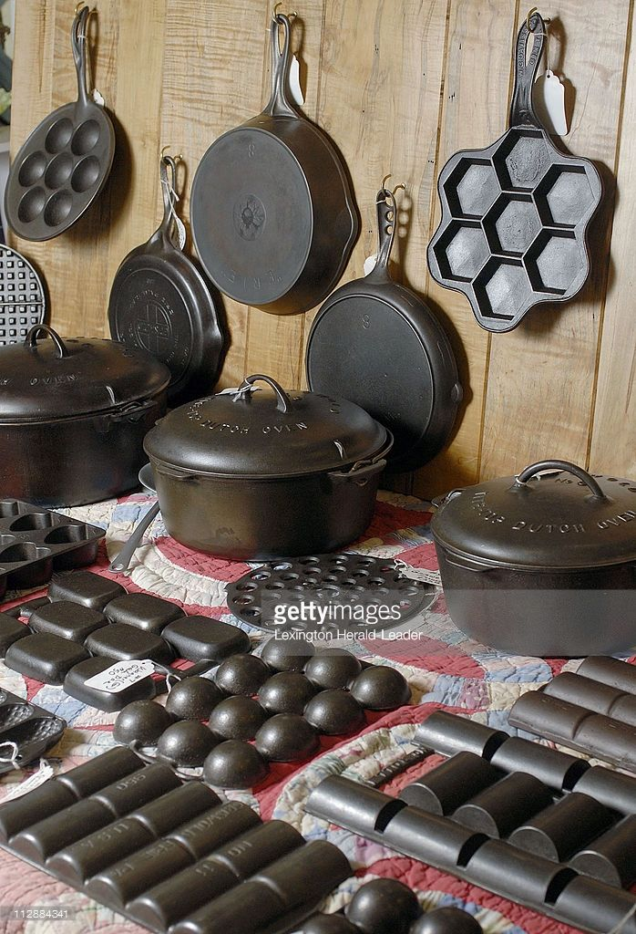 Cast Iron Collector Jim Nance _ sells cast iron skillets, Dutch ovens, muffin pans, waffle irons and brownie pans, at an antique show at Scott County High School in Georgetown, Kentucky, March 21, 2009. (Photo by Mark Ashley/Lexington Herald-Leader/MCT via Getty Images)