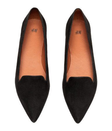 Black. Flats with pointed toes. Faux leather lining and insoles and rubber soles.