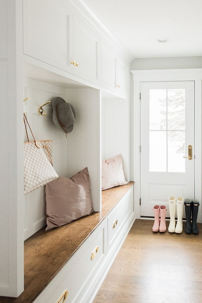 White Mudroom Lockers With Wood Stained Bench And Hardwood Floors