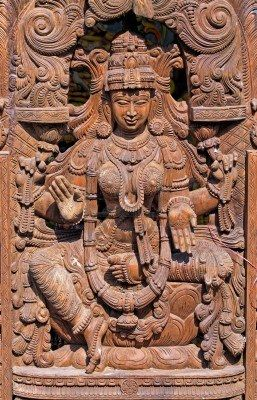 """Wooden Statue of Hindu Goddess Lakshmi -   Goddess of wealth and prosperity, both material and spiritual. The word ''Lakshmi'' is derived from the Sanskrit word Laksme, meaning """"goal."""" Lakshmi, therefore, represents the goal of life, which includes worldly as well as spiritual prosperity. In Hindu mythology, Goddess Lakshmi, also called Shri, is the divine spouse of Lord Vishnu and provides Him with wealth for the maintenance and preservation of the creation."""