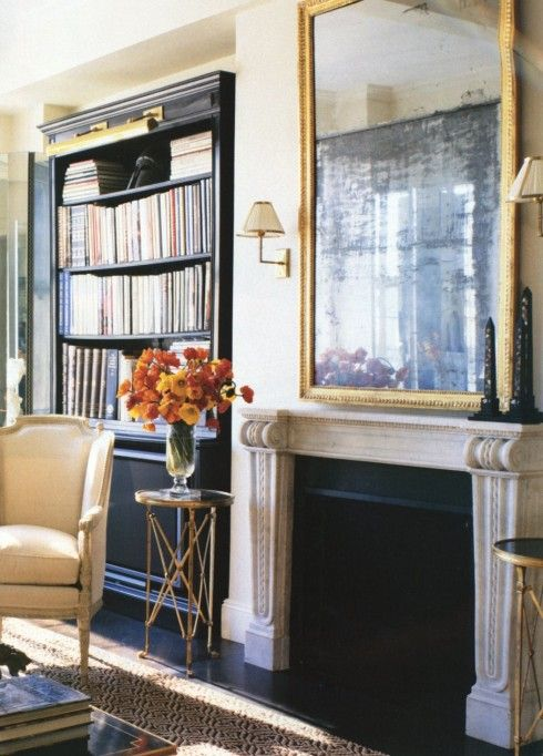 Alexa Hampton- martini tables flanking fireplace