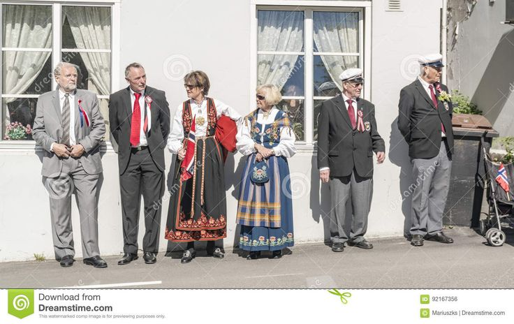 Norwegians In Traditional Costumes Watch The Parade - Download From Over 59 Million High Quality Stock Photos, Images, Vectors. Sign up for FREE today. Image: 92167356
