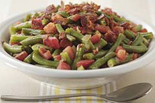 Green beans, onions and bacon are slow-cooked for a savory side that'll not only wow 'em at the potluck, it also can fit into a healthy eating plan.