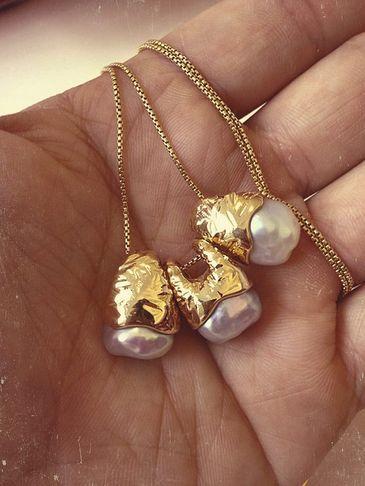 Gold pearls teeth necklace.  Follow Phan Dental Today! https://www.facebook.com/phandentalyeg https://twitter.com/PhanDental