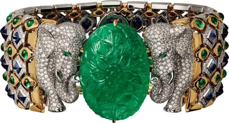 CARTIER. Bracelet - platinum, yellow gold, one 79.50-carat carved emerald from Colombia, cabochon-cut emeralds, cabochon-cut sapphires, emerald eyes, brilliant-cut diamonds.