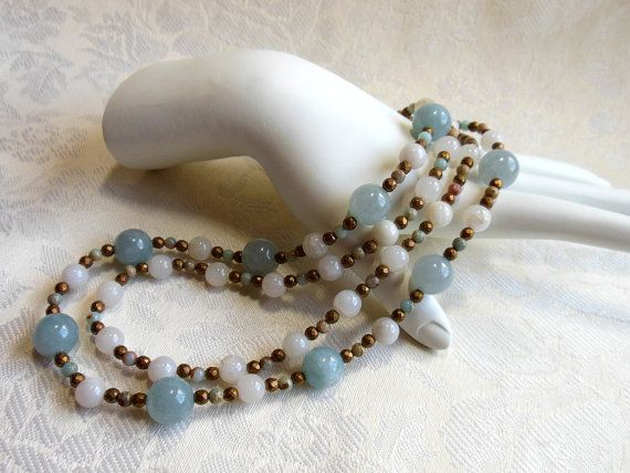 Blue and white necklace with bronze, two strand necklace with blue fossil coral, white agate, African opal, bronze toggle and spacers