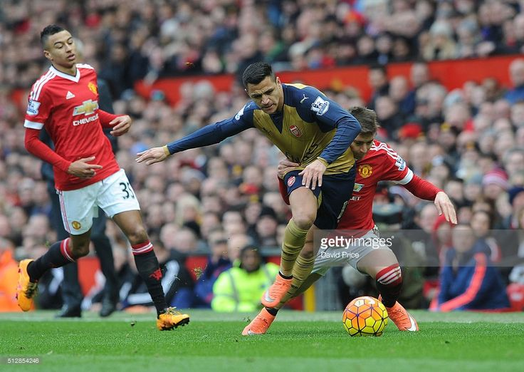 Alexis Sanchez of Arsenal is challenged by Guillermo Varela of Man Utd during the Barclays Premier League match between Manchester United and Arsenal at Old Trafford on February 28, 2016 in Manchester, United Kingdom.