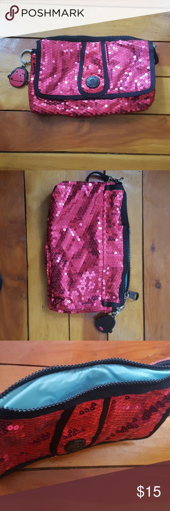 Kipling redish pink glitter clutch Like new. Missing monkey face on one side of keychain. 2 inside pockets, 1 outside zipper with baby blue accent. Kipling Bags Clutches & Wristlets