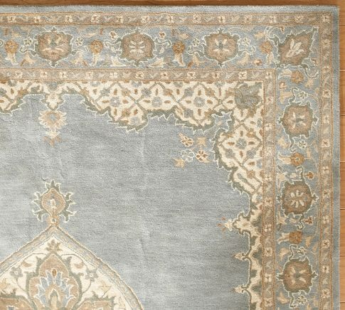 love this rug. to bring together the light blue from the dining room and the brown and cream/white color scheme I have planned for the living room