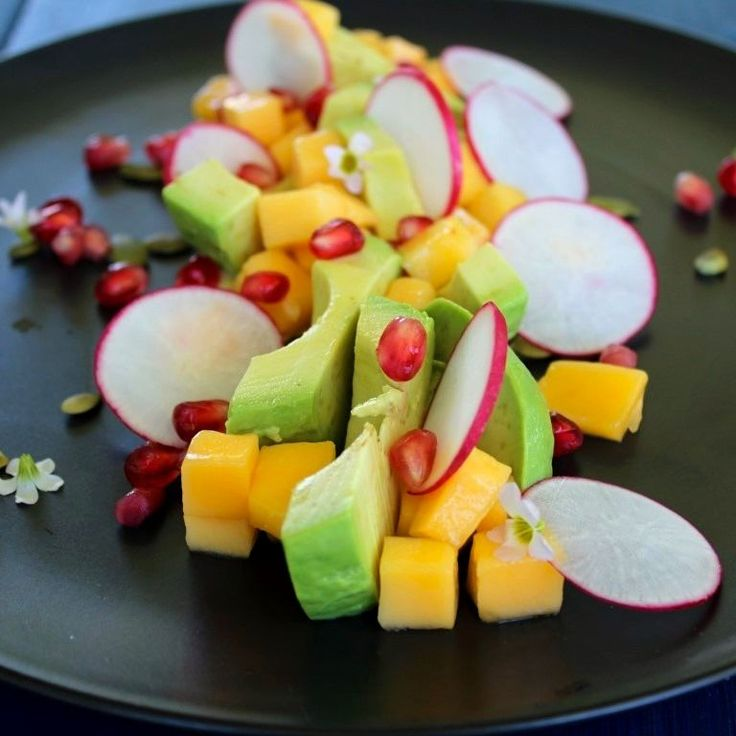 A Mango, Avocado, Radish & Pomeranate salad I made recently to try out a new recipe for a Coriander & Jalpeono Hummus.  The hummus needs to be worked on, which I am hoping to do over the next week, but I absolutely loved the salad!