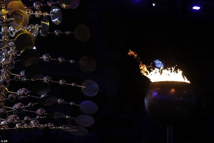 Powerful: The Olympic flame burns before the start of the Summer Olympics closing ceremony in Rio